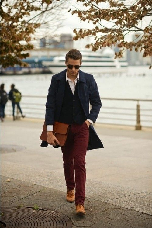 Shop this look for $484:  http://lookastic.com/men/looks/overcoat-and-longsleeve-shirt-and-cardigan-and-chinos-and-oxford-shoes-and-briefcase/135  — Navy Overcoat  — White Longsleeve Shirt  — Navy Cardigan  — Burgundy Chinos  — Brown Leather Oxford Shoes  — Brown Leather Briefcase