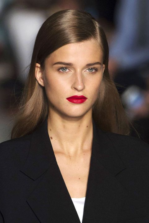 Candy apple red at DKNY — try Crimson & Clover Tinted Lip Conditioner or Wild Child Lipstick