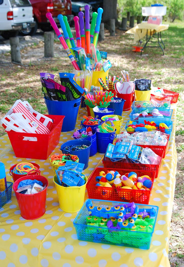 Small containers filled with prizes, placed on a table = Kids go there to choose their prize? Ask Brooke and RTG about this.