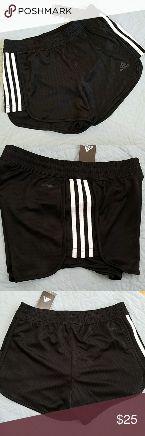 Adidas shorts black NWT Designed to move with you, these Women's Climalite training shorts are made of sweat- wicking lightweight fabric. The slim-fit shorts feature 3-Stripes on the side panels.  100% polyester/lining 92%polyester/8%spandex adidas Shorts Skorts