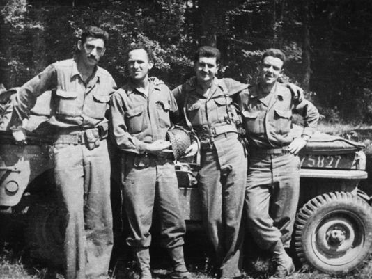 J.D. Salinger, left, after the Normandy invasion with his fellow counterintelligence officers. The group called itself 'The Four Musketeers.' Salinger landed at Utah Beach, fought through Normandy, the Hurtgen Forest, the Battle of the Bulge, and liberated Dachau, then Paris. Checked himself into an army hospital in Germany for battle fatigue/PTSD.