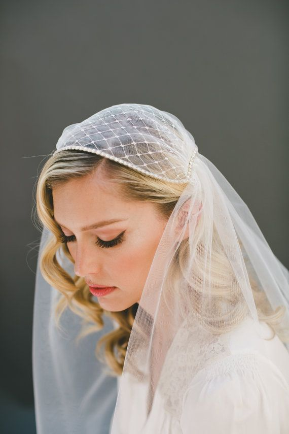This vintage-inspired Juliet Cap Wedding Veil will usher you down the aisle with the grace of a Great Gatsby timelessness and a Bohemian flair. She