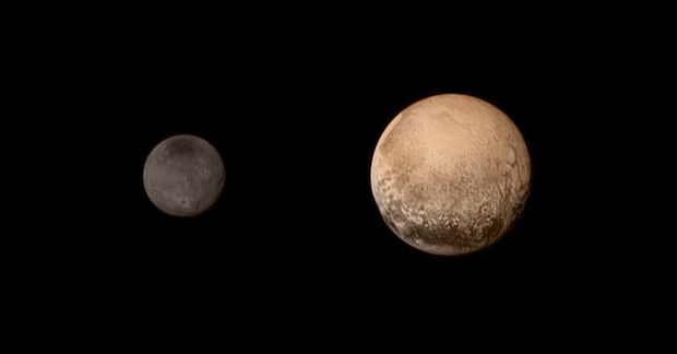 The first colour pictures of Pluto and its moon Charon