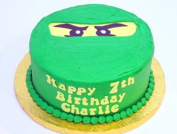 Lego Ninjago Cake- This would be so easy KT. Round then put one of the laminated eyes on it.