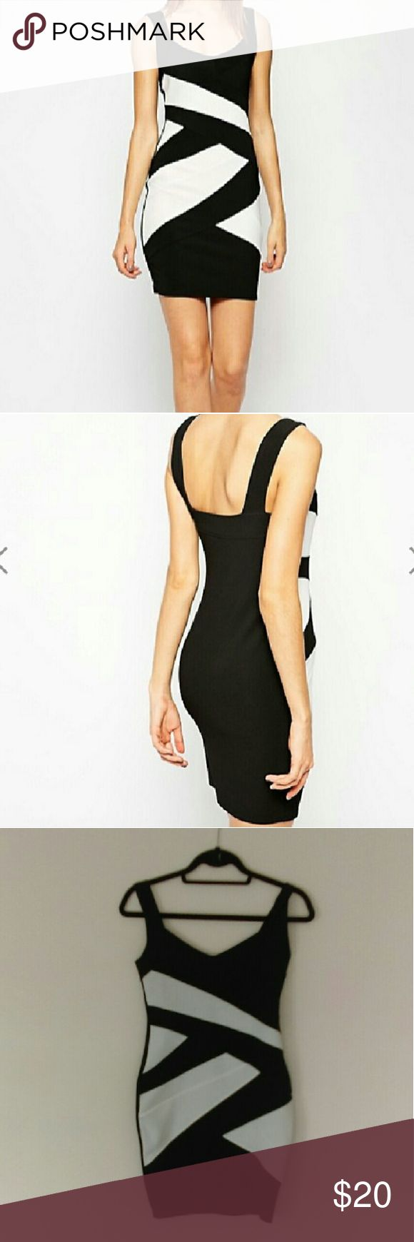 ASOS Black & White Color Block Bandage Dress Super sexy dress fits like a glove!  97% polyester 3% elastane I only wore this dress once and loved it but I've gained some weight so it's time to let it go. Lol ASOS Dresses