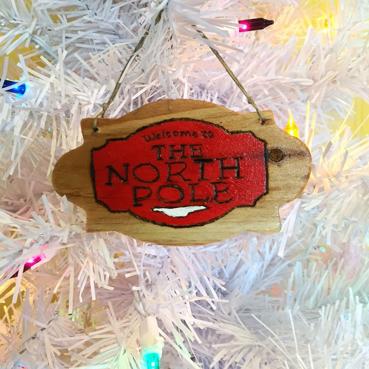 Hand painted and wood burnt 'Welcome to the North Pole' Christmas ornament by EarthDiverCreations on Etsy https://www.etsy.com/ca/listing/475141114/hand-painted-and-wood-burnt-welcome-to