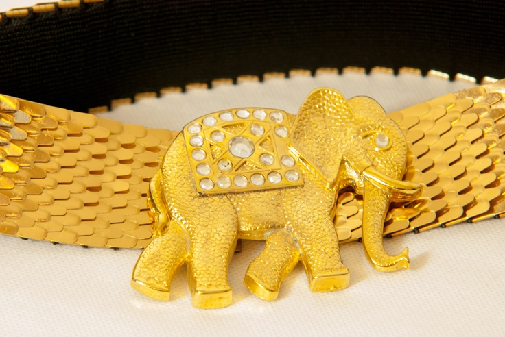 Gold-colored belt buckle in the shape of an elephant