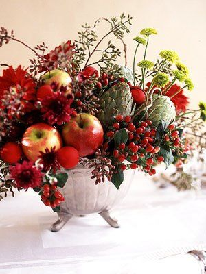 Create a dimensional, edible centerpiece using apples and artichokes. Source