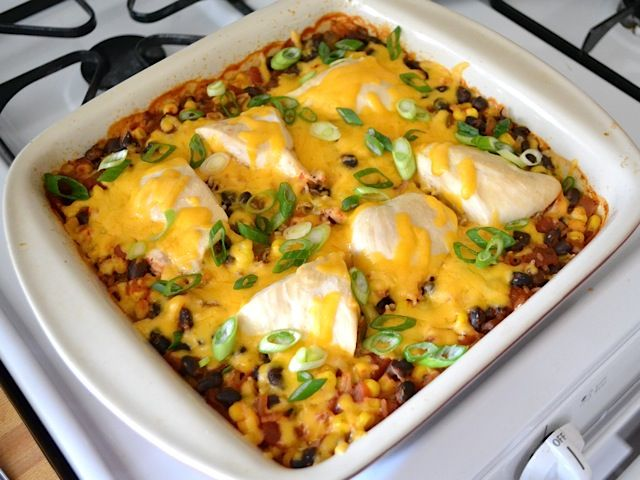 1 cup uncooked rice 1 cup frozen corn kernels (thawed) 1 (15 oz.) can black beans 1 (16 oz.) jar salsa 1 cup chicken broth ½ Tbsp chili powder ½ tsp oregano 2 large (1.5 lbs.) chicken breasts 1 cup shredded cheddar cheese 2 whole green onions, sliced