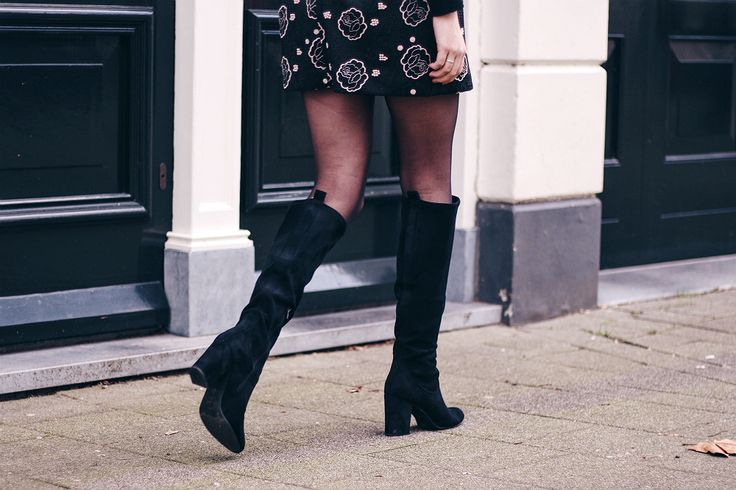 Fashion blogger from Amsterdam wearing a dress over a turtle neck. | outfit, style, inspiration, boots,