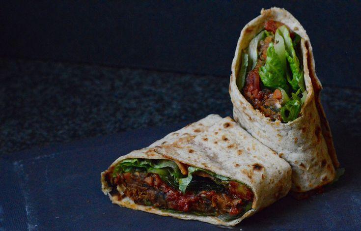 This delicious mushroom meatball wrap includes meatballs by Thug Kitchen, marinara sauce and greens. From 300sandwiches.com