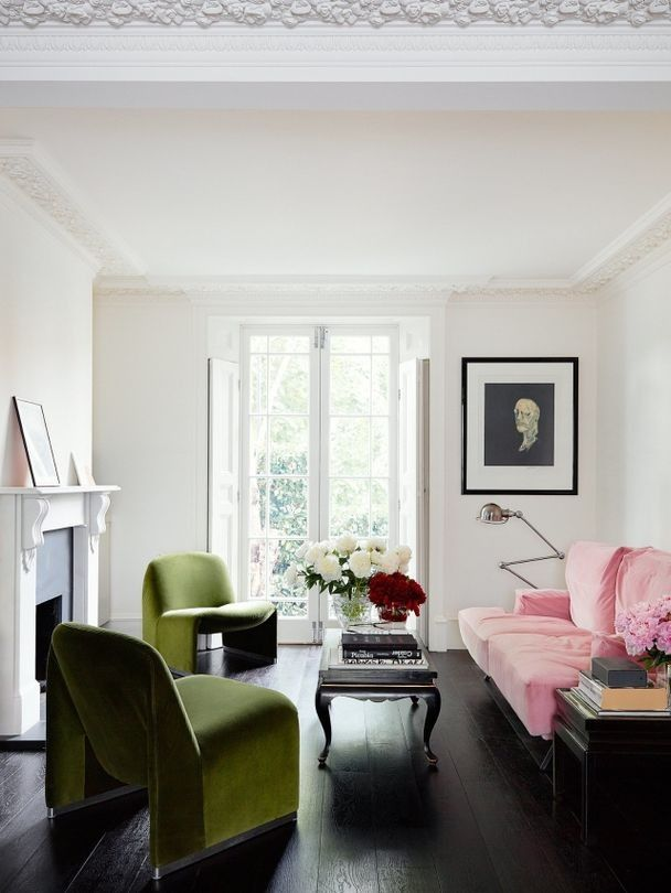 Inside Simone Rocha's art-filled terrace home: A pastel pink sofa and olive green chairs in the living area with a portrait of William Blake by Francis Bacon.