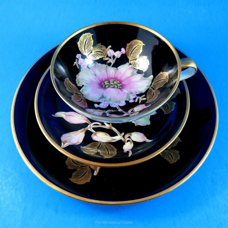 PINK and White Floral on Black Bavaria Tea Cup, Saucer and Plate Trio Set - CAD $145.00. Pink and White Floral on Black Bavaria Tea Cup, Saucer and Plate Trio Set This delightful cup and saucer set is in very good condition, free of chips, cracks or crazing, and is sure to please a discriminating collector of fine china, or complement a prized tea service on those special occasions. This lovely set is delicately accented, well-balanced to the touch and beautifully crafted, and offers itself…