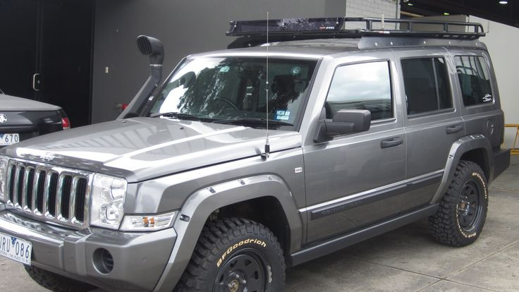 Jeep Commander with Oval Steel roof rack installed on