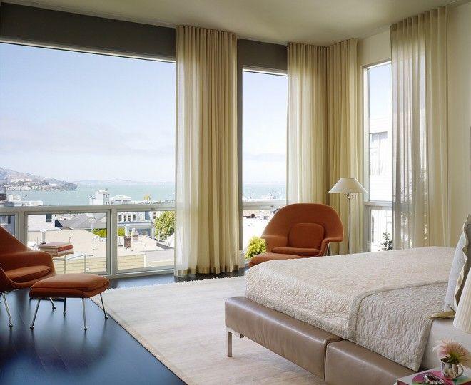 Elegant Ceiling Curtain Track  fashion San Francisco Modern Bedroom Inspiration with  armchair curtains dark wood floor floor to ceiling windows gold hem leather bed orange