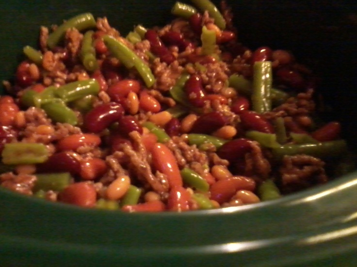 Three Bean Bake:  1 # Hamburg, browned, drained and rinsed  1 can Pork & Beans  1 can Dark Kidney Beans, drained & rinsed  1 can Light Kidney Beans, drained & rinsed  1 can Cut Green Beans  1/4 cup Brown Sugar or Molasses  1/2 cup Catsup  1 onions, diced  1 tsp Liquid Smoke  Place in Crock Pot and cook on low for 4 -10 hours, or until heated thoroughly. (Easy recipe to alter. Use smoked sausage instead of Hamburg. Add garlic.)  Serve with Tortilla or Corn chips or top with Durkee Onions.