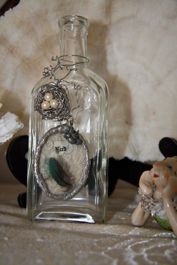 Love this bottle with the soldered charm and wire birds nest
