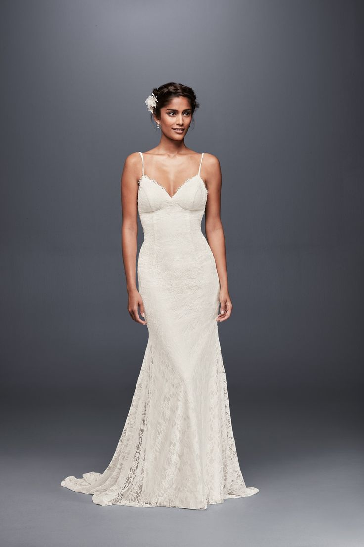 For the beach bride, a sultry spaghetti strap soft lace sheath wedding dress with low back by Galina available at David's Bridal for your seaside nuptials