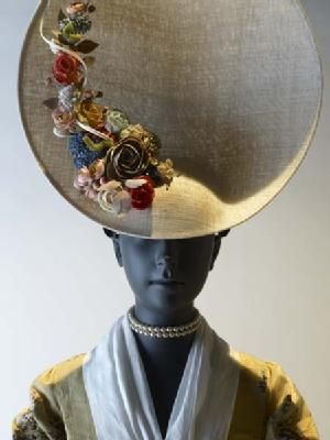 Phillip Treacy hat, inspired by 18th c. Straw hats. - brilliantly managed. clear historical nods, to victorian england and a bit to the victorian idea of 'the orient,' yet at the same time, very, very modern. fun, classy. well done.