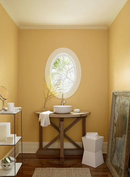 Looking for warm colors that complement existing ones--BM-maple sugar, dark mustard, cork, golden tan.  This is August Morning.
