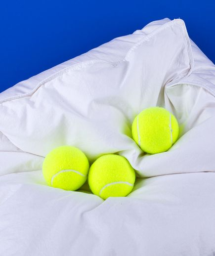 Tennis Ball as a Comforter Fluffer | Speed up the drying time of bulky bedding by tossing a couple of tennis balls in the load.