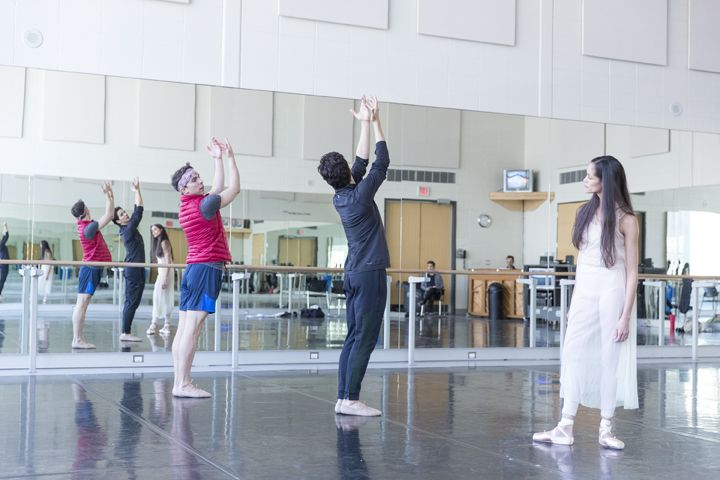 First Soloist Tanya Howard and Dylan Tedaldi in rehearsal with Choreographer Guillaume Côté for Le Petit Prince. Photo by Aleksander Antonijevic.