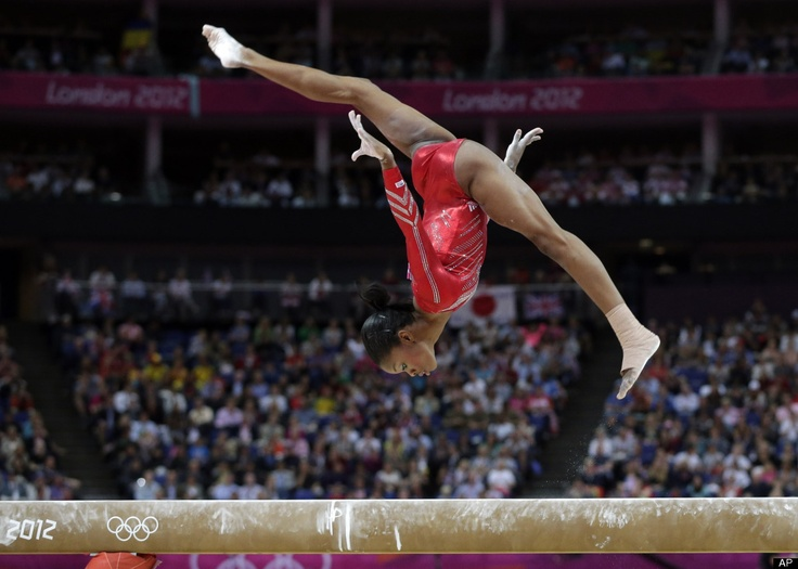 U.S. gymnast Gabrielle Douglas performs on the balance beam during the Artistic Gymnastics women's team final at the 2012 Summer Olympics.