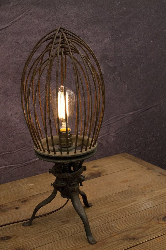 Amazing vintage industrial mixing whisk turned into a desk lamp. By Brian Poe, available here:  https://www.etsy.com/listing/207052107/large-vintage-industrial-whisk-desk  Wired using parts from www.snakeheadvintage.com