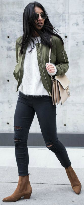 Kayla Seah + cute and casual + cropped khaki bomber + suede Chelsea boots + distressed black denim jeans + everyday wear  Bomber: Topshop, Sweater: Mage, Jeans: J Brand, Boots: Sandro, Bag: Chloe.