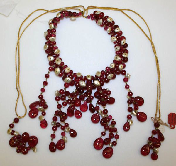 Necklace Design House: House of Chanel (French, founded 1913) Date: 1950s Culture: French Medium: metal, glass, pearls Dimensions: Length: 35 in. (88.9 cm) Credit Line: Gift of Mrs. Beatrice Glass, 1974