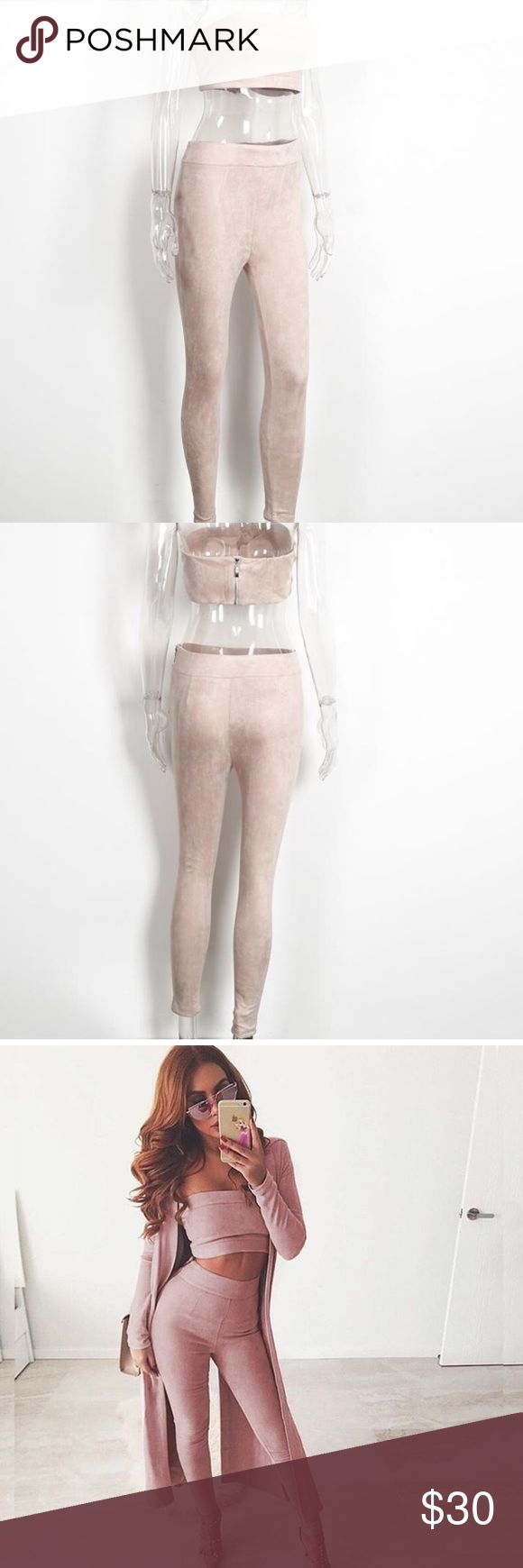 Nude Two piece suede pants set Check out this trendy two piece set. This is a nude pink tone  suede bandeau top with a zipper in the back and the matching pants that fit incredibly. The pants have a side zipper Pants Jumpsuits & Rompers