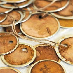 Aged tags using walnut ink.