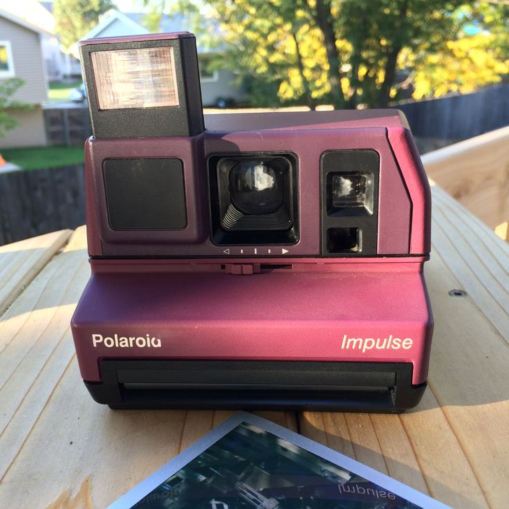 I just love the color of this rare purple Polaroid Impulse! For sale in my etsy shop.