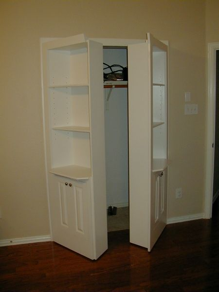 Hidden shelves | Double hidden door with three shelves and two cupboards ajar