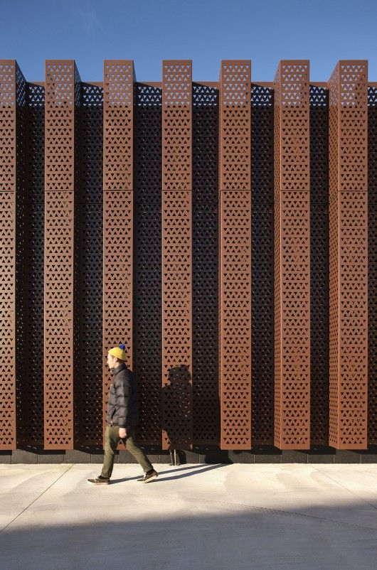 Rust coloured aluminium fascade of the modern extension to the Carnegie Library, Thames NZ | Architectus, photo © Simon Devitt