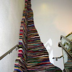"""Susie Brandt- """"Mine"""" view from above Cut and stacked wool. 170"""" x 59"""" x 61"""" Installation in the observation deck stairwell ? Albany International Airport, Albany, NY"""