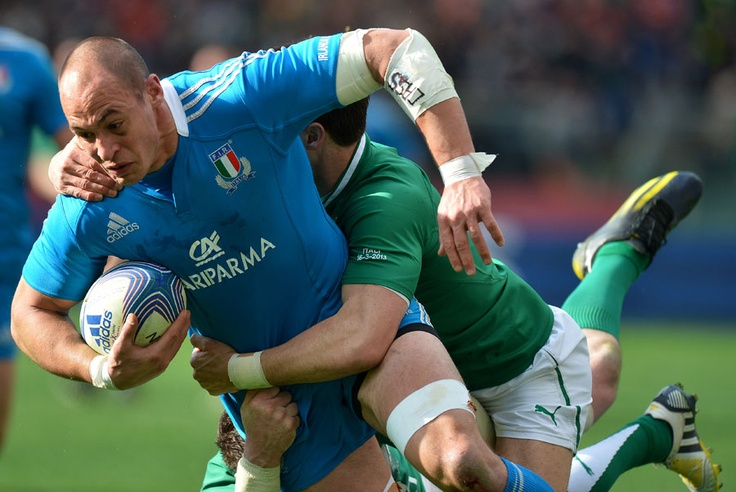 Italy's Sergio Parisse is hauled down by the Ireland defence