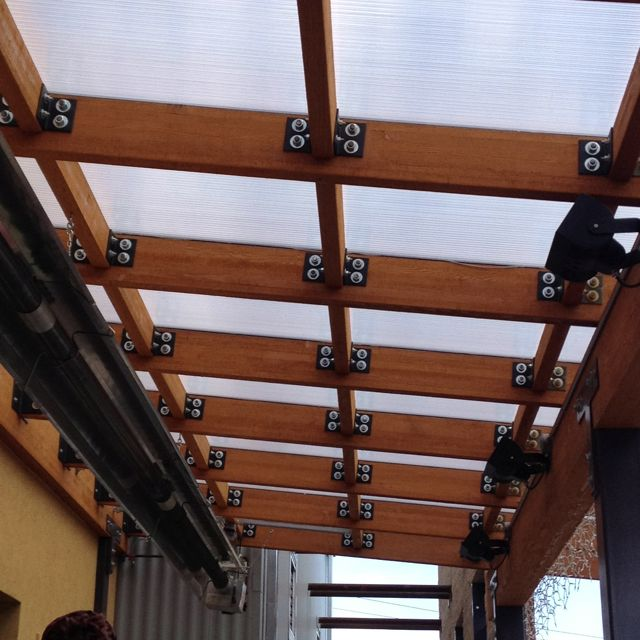 Roof at Gravity 1020, polycarbonate and wood, different from pergola