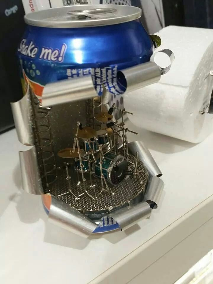 There's someone out there who spends his or her time creating tiny drum sets inside soda cans. I think it's damn' creative and neat.