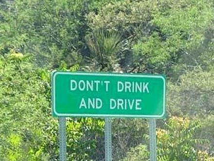 This sign says dont't drink and drive. there is a misspelled word. Grammar win! don't drink and drive.