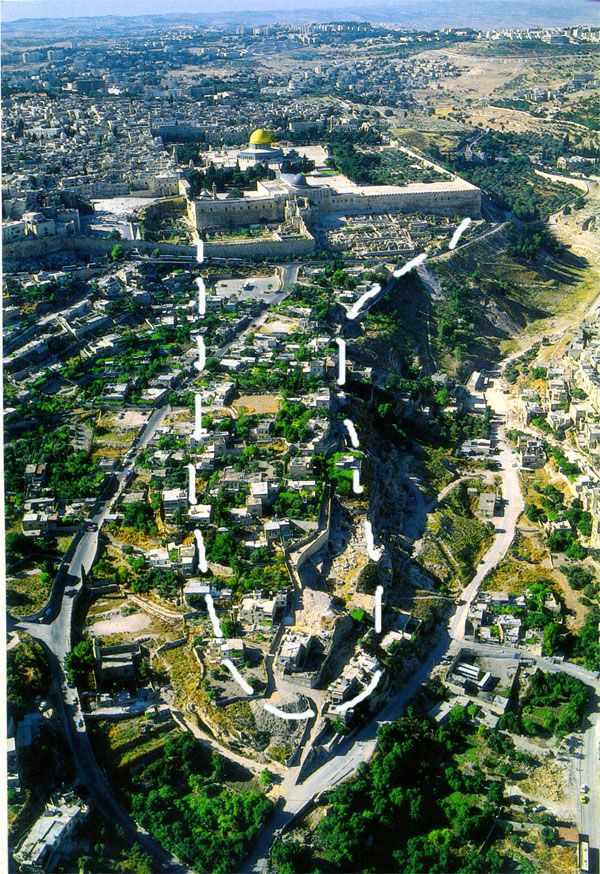 Ariel view of the modern location of the City of David (Ophel) - Looking from South to North.  The white broken-line is where the ancient city of David was located (which is outside the city wall today).  The gold domed building is the Muslim shrine called the Dome of the Rock.  It is surrounded by ancient retaining wall of the Herodian Temple mount.  This picture gives distance perspective.  The Kidron valley can be seen on the left (?) side.
