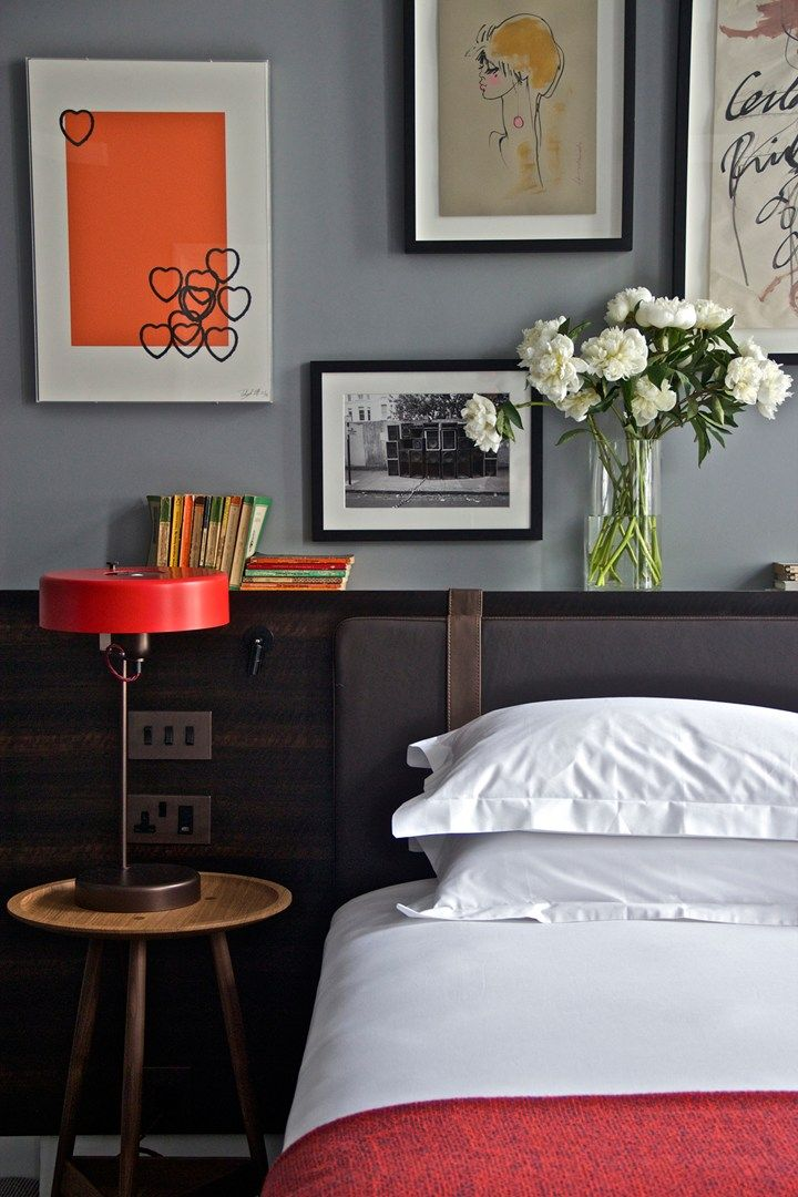Original artwork, vintage Penguin paperback books and retro homewares furnish the master double bedroom at The Laslett Hotel in Notting Hill, London. Photo by: Matthew Buck