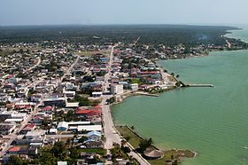 Aerial of Corozal Town; Corozal, Belize is the ultimate tropical paradise that allows travellers and expats to experience the slow, mindful life. With yoga, meditation, beach walks and general quiet time – Corozal is one of the greatest, most peaceful places to follow your dreams and have a penny or two to spare.