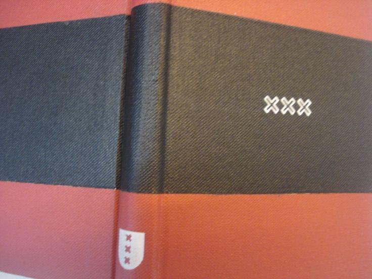 Amsterdam dummy boekje met Amsterdamse kruisjes op dummyboekje van klein formaat kleiner dan a5 -