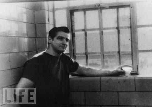 Self-confessed Boston Strangler Albert DeSalvo stands in jail for unrelated crime in an undated photo.