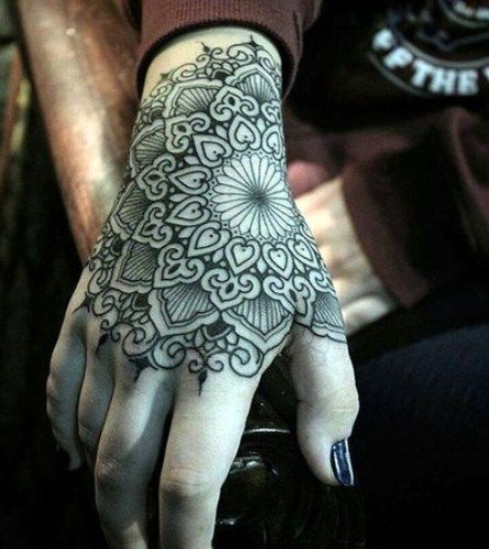 Good looking hand tattoo in mandala design