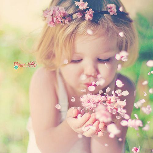 I want my wedding photographer to take a picture of my flower girl blowing flowers! so cute!