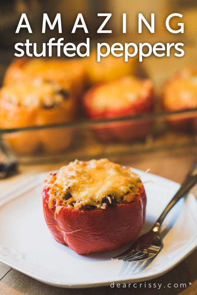 Amazing stuffed peppers _ Rice, Savory beef and sausage stuffed peppers, topped with delicious melted cheddar cheese.