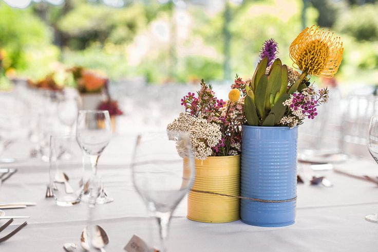 Spray painted cans for table settings, filled with Australian natives