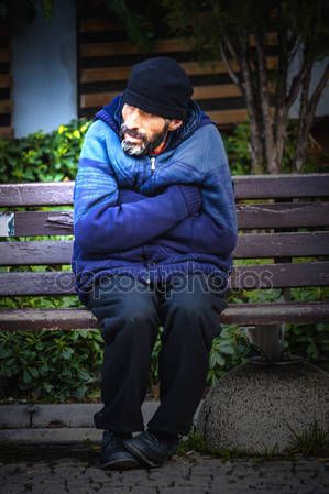 Beggar man sitting on a bench in Izmir (Turkey) – Stock Editorial Photo © carlotoffolo #147767865